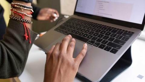 faculty member using laptop