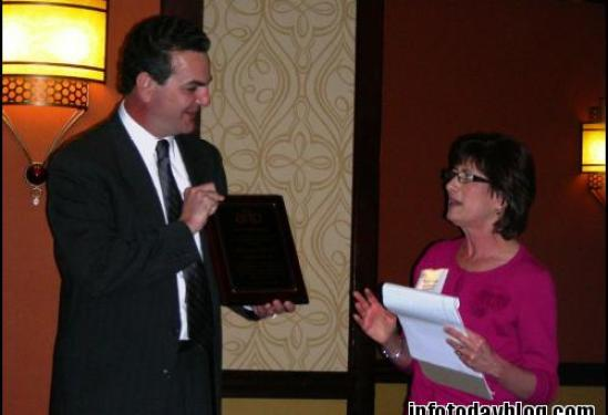 Marcy Phelps presents the AIIP Award to Daryl Scott, Attaain President and CEO