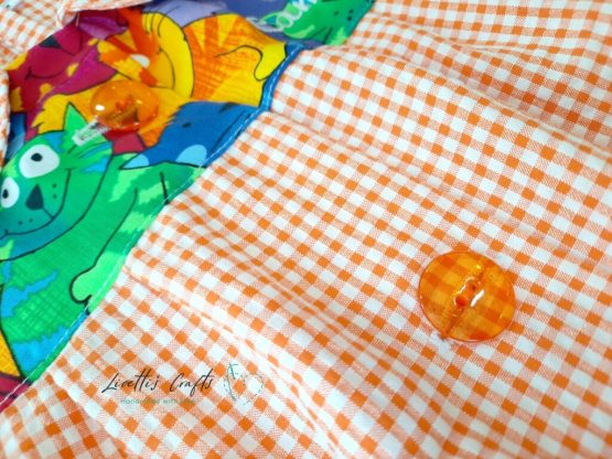 detalles bata colegio cuadros naranja