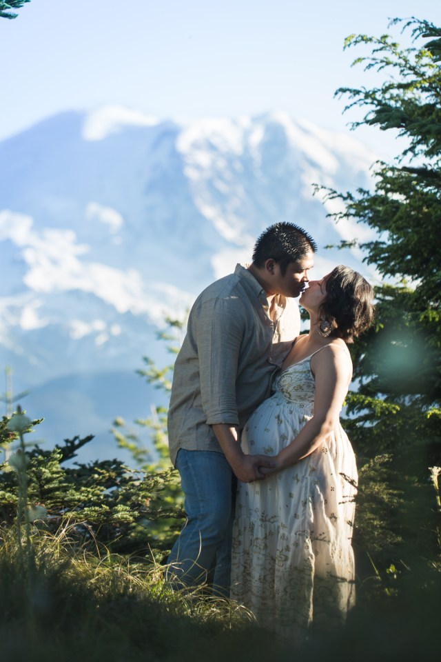 Couple stands in front of tacoma photographer in front of Mount Rainier