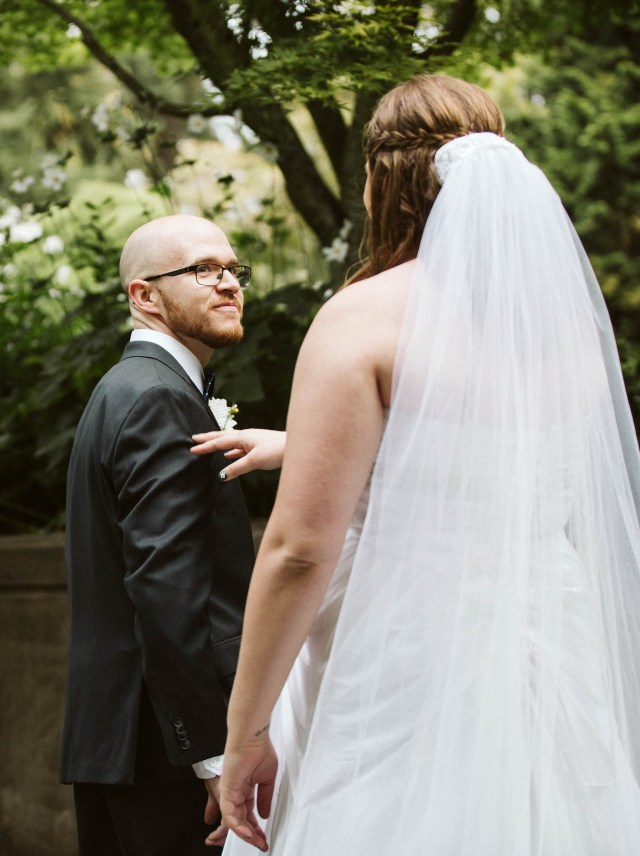 Groom turns around to see bride for the first time during first look.