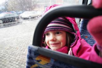 girl on school bus winter