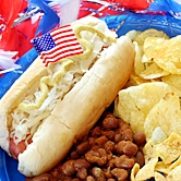 Hot dog in bun with chips