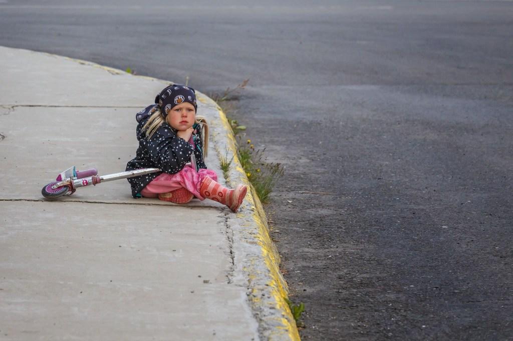 A girl on a street in Þingeyri