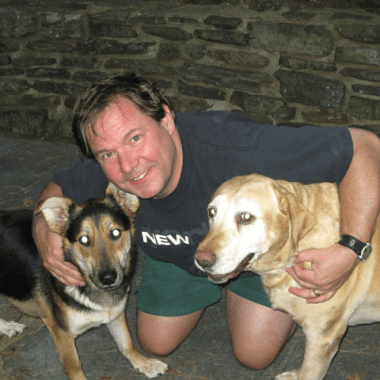 Jim with Charlie (left) and Molly at the lake house in the summer of 2010