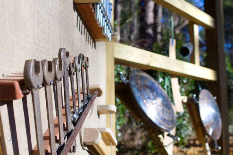 Closeup of a xylophone-like instrument made from wrenches.