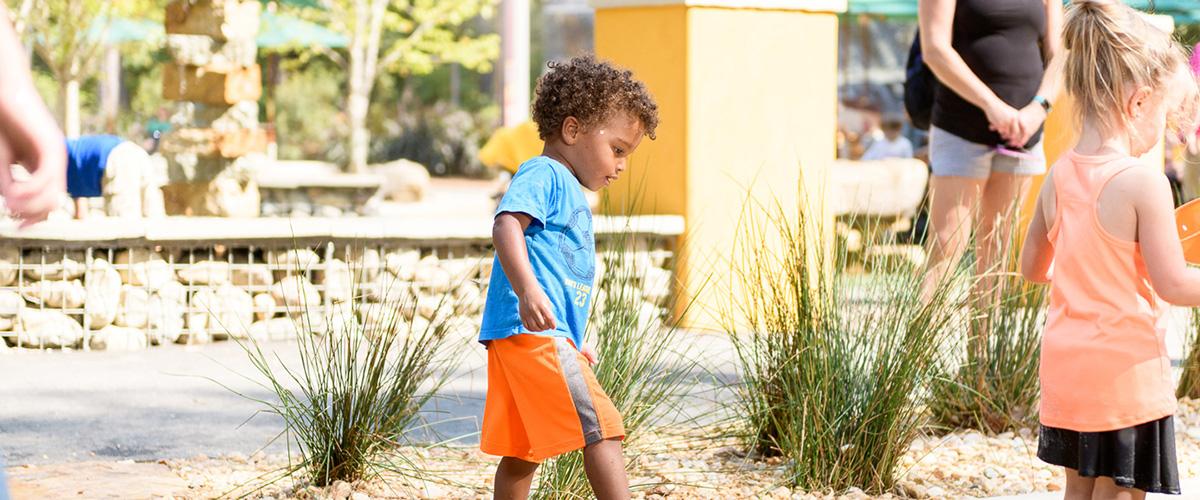 A boy walks in Earth Moves