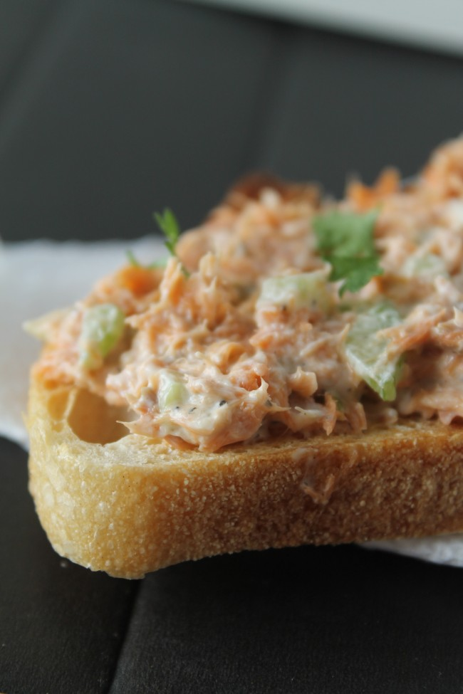 Smoked salmon dip spread over a piece of toast.