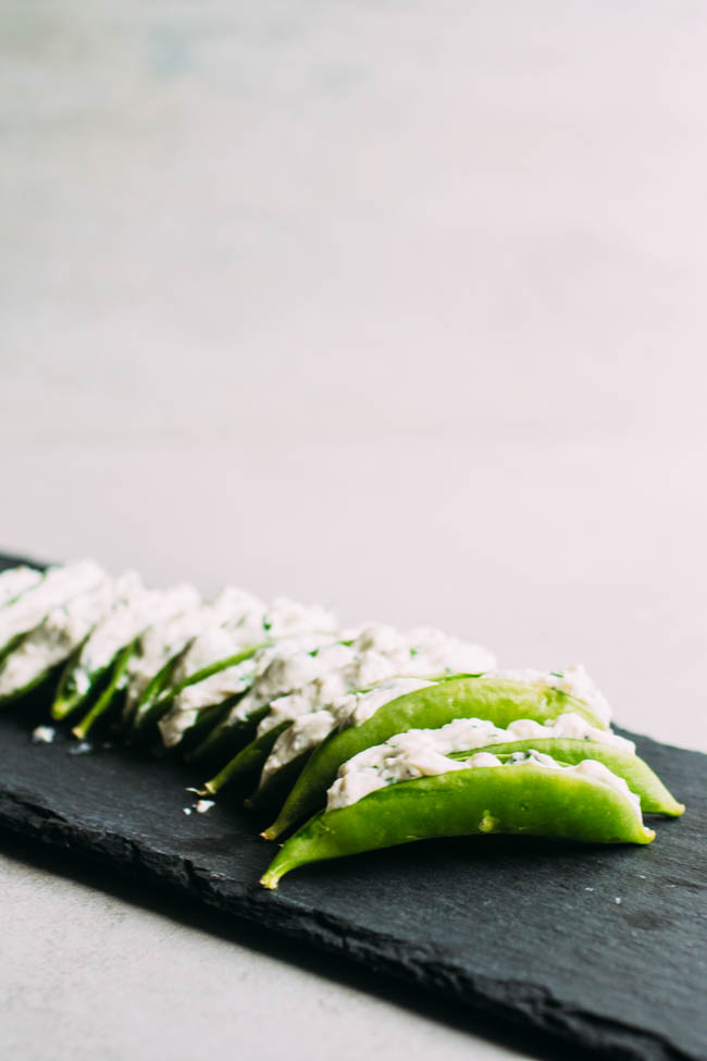 Herb and Cheese Stuffed Snap Peas - This easy but elegant spring appetizer is perfect for outdoor entertaining! Vegetarian.