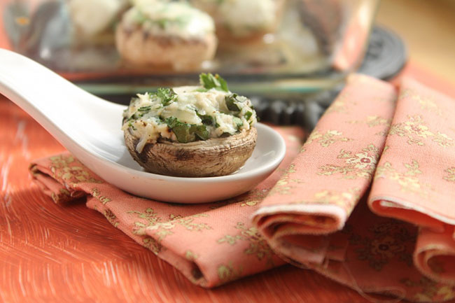 Herb and Cheese Stuffed Mushrooms | These easy stuffed mushrooms are filled with a tasty herb and cheese dip and are the perfect appetizer for your next party! Vegetarian.
