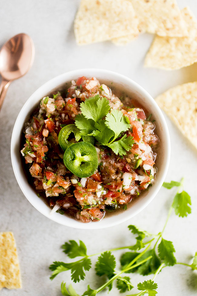 Fresh tomato salsa with cilantro, jalapeno, and onions - ready in just 5 minutes with a food processor!