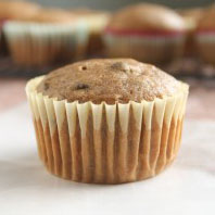 Banana chocolate chip muffin in a light yellow wrapper.