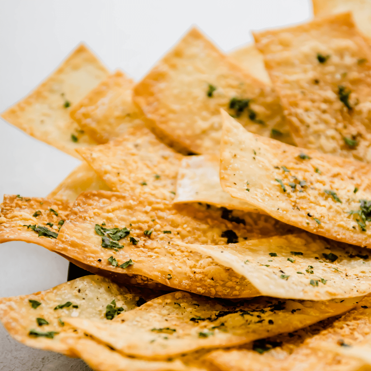Homemade crackers on a black plate.