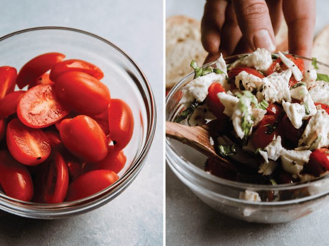 Wooden spoon mixing tomatoes, herbs, and mozzarella together in a small bowl.