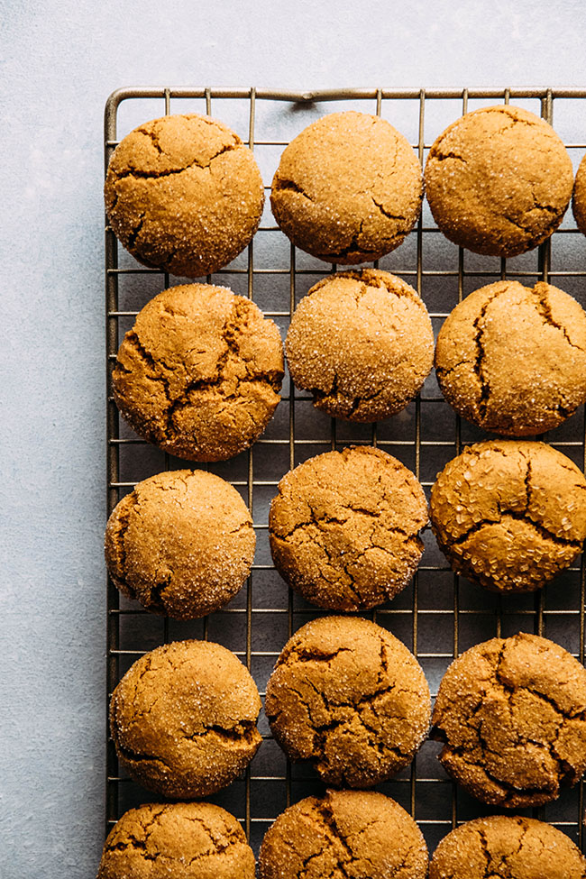 overhead photo of gingersnaps grouped close together on a cooling rack