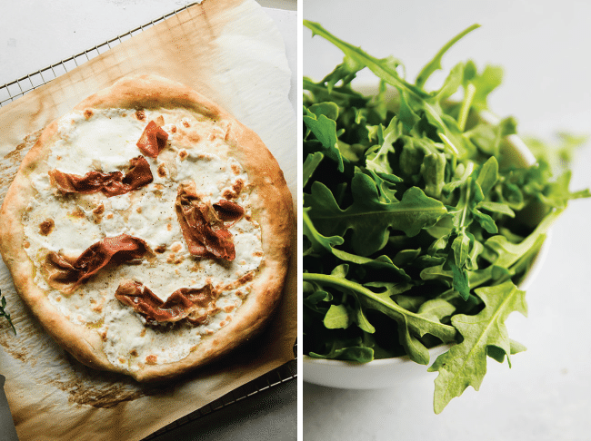 White pizza topped with prosciutto next to a small bowl of fresh arugula