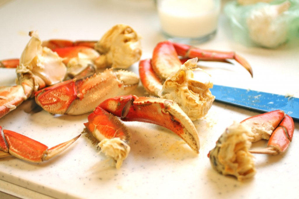 A cooked crab separated into pieces.