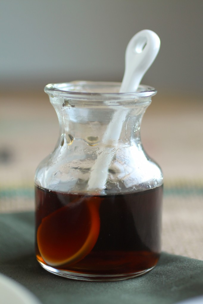 Small glass jar filled with maple syrup.