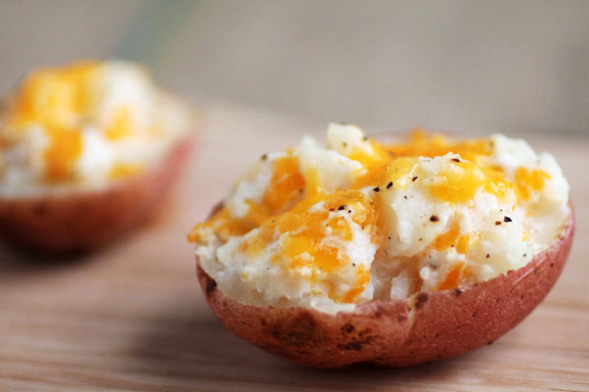 Twice Baked Potatoes With Greek Yogurt | Lighten up your favorite baked potato appetizer with protein-packed Greek Yogurt for all of the flavor with none of the guilt! Vegetarian.