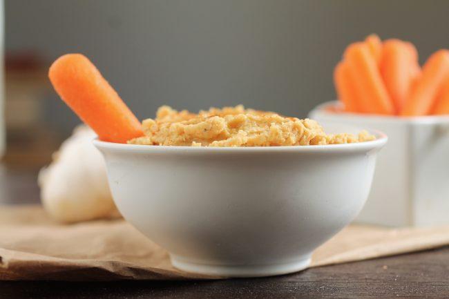 Roasted Garlic Hummus   Make your favorite hummus dip at home with this easy roasted garlic hummus recipe!