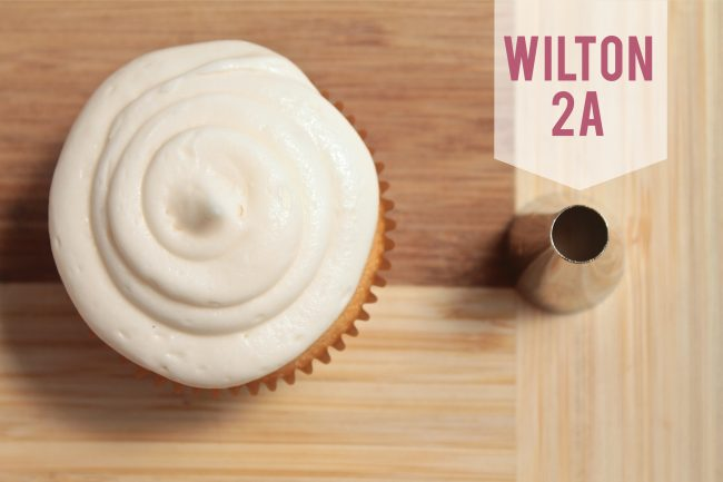 Wilton 2A frosting tip next to a cupcake frosted with that tip.