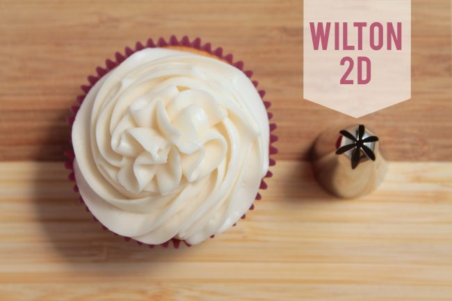 Wilton 2D frosting tip next to a cupcake frosted with that tip.