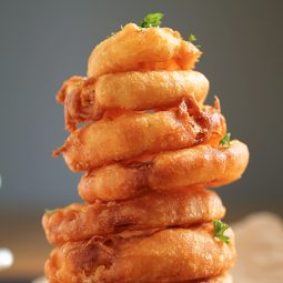 Onion rings arranged in a stack.
