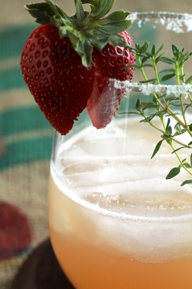 Strawberry Thyme Margaritas | Give your favorite margarita recipe a twist with these strawberry cocktails. A sprig of thyme gives an earthy twist to these summertime drinks!
