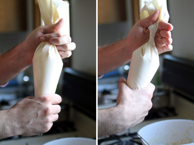 Hands twisting a white pastry bag to seal the top.