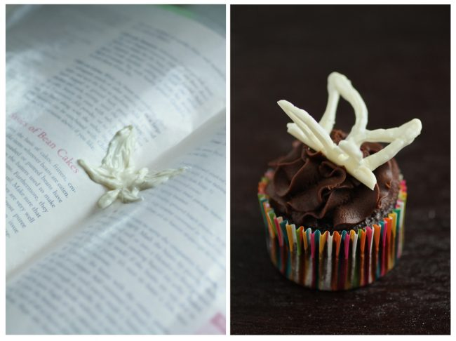 Chocolate cupcake topped with a white chocolate butterfly.