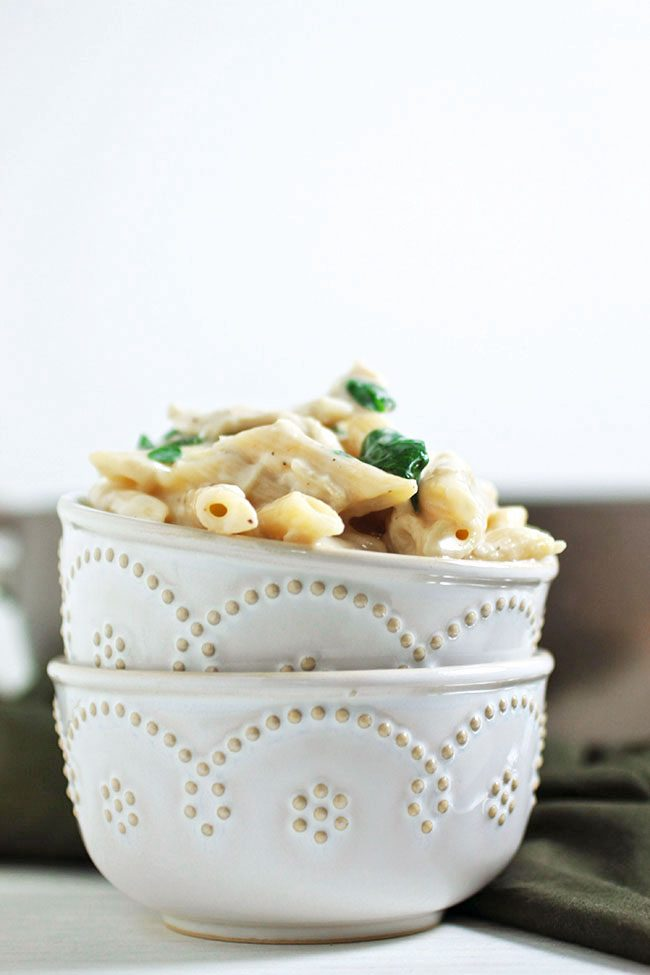Lightened-up pasta in white sauce - an easy chicken spinach alfredo recipe.