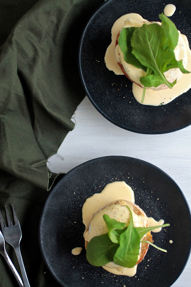 This simple crab eggs benedict is sure to be a hit at your next brunch! With a homemade hollandaise sauce made in under a minute with an immersion blender.