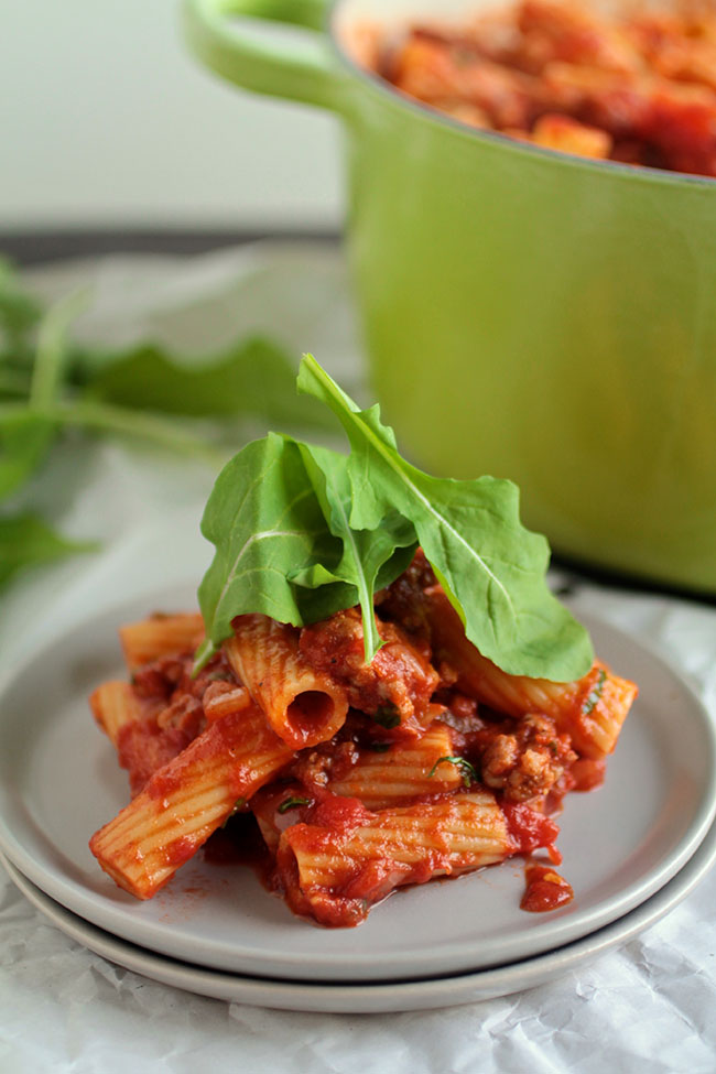 Sausage pasta recipe with spicy tomato sauce and arugula