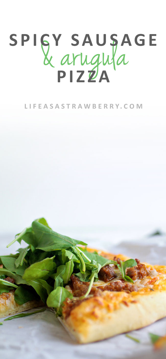 Spicy Sausage and Arugula Pizza | This easy homemade pizza recipe needs just a handful of ingredients - spicy Italian sausage, a quick tomato sauce, mozzarella cheese and a handful of crisp, fresh arugula. Have this pizza recipe on the table in less time than it takes to wait for delivery!