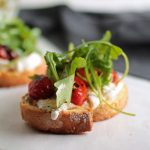 Blistered Tomato Arugula Crostini with Burrata