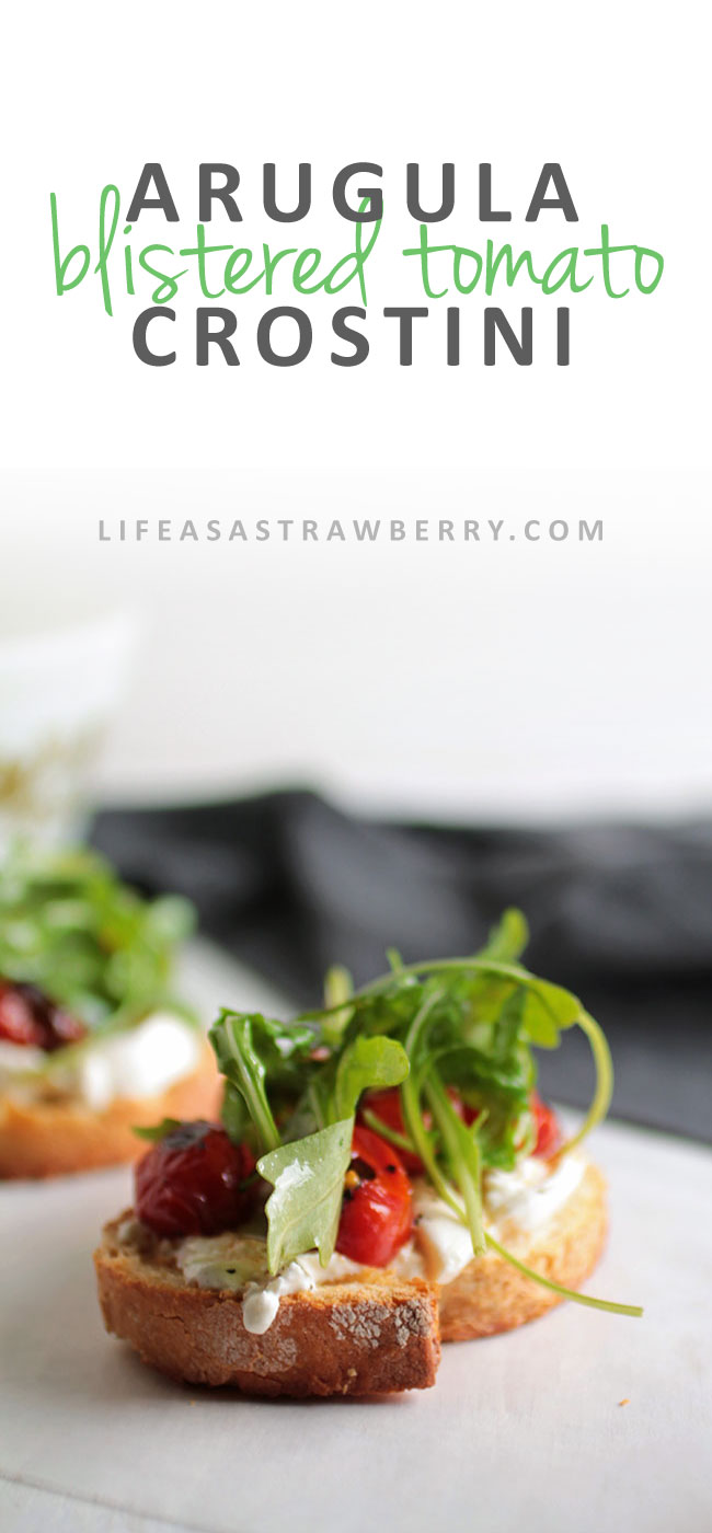 Easy Arugula and Blistered Tomato Crostini | This easy crostini appetizer is sure to be a hit! Lightly dressed arugula with a lemon vinaigrette, flavorful burst cherry tomatoes, and creamy burrata cheese make this a delicious recipe. Vegetarian.