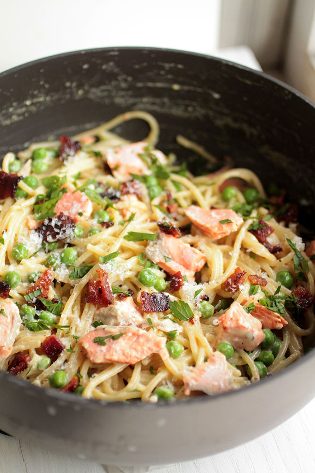 A tasty salmon carbonara recipe with candied bacon and spring peas. A fun twist on an authentic Italian favorite!