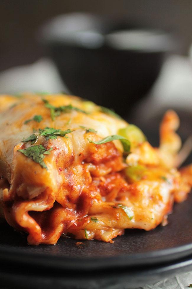 An easy lasagna chicken enchilada bake