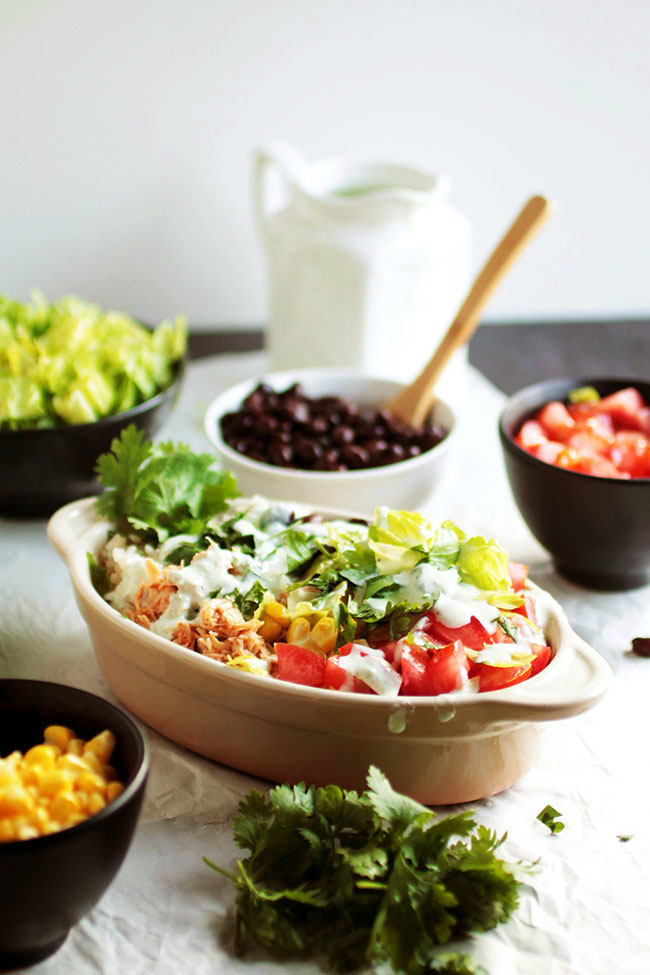 One of our favorite chicken crock pot recipes is the base of these tasty, healthy burrito bowls!