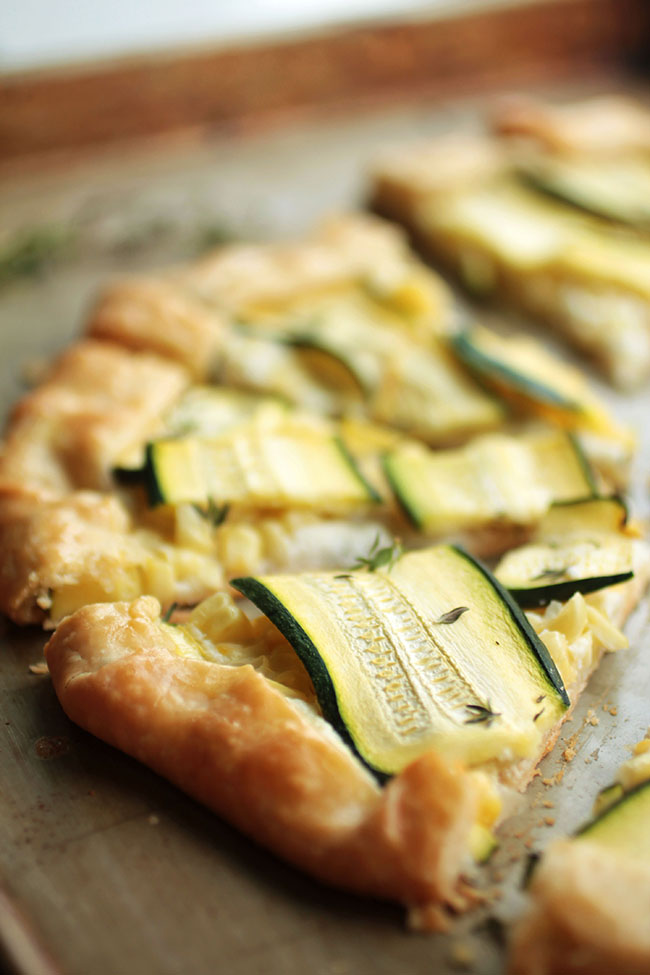 Savory galette with whipped feta cheese, summer corn and fresh zucchini. Vegetarian.