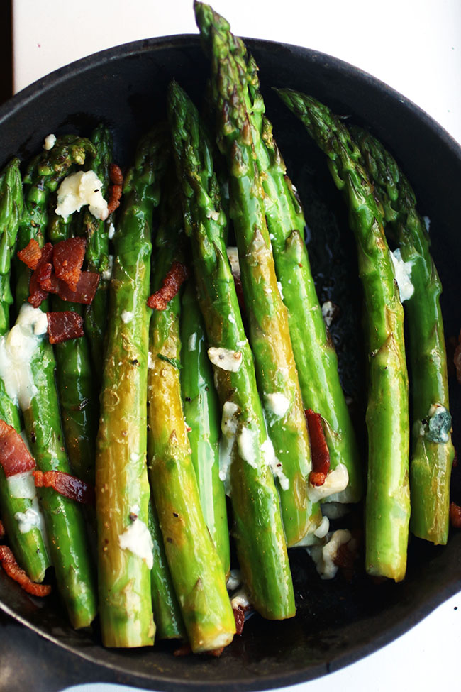 Asparagus spears in a cast iron skillet.