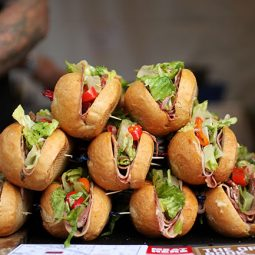 Sub sandwiches stacked in a pyramid.