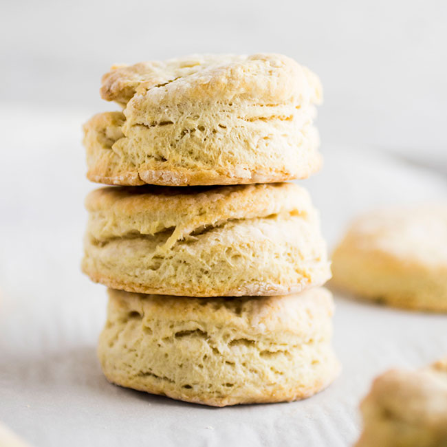 stack of three vegan biscuits on a white background