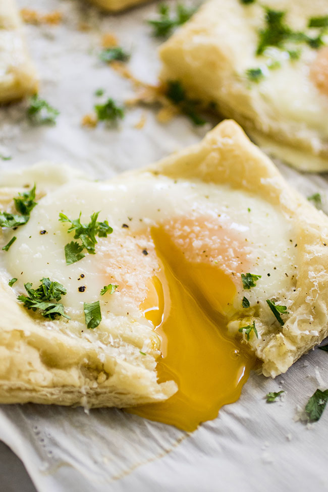 egg yolk spilling out of sunny side egg on puff pastry