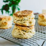 Side photo of two biscuits stacked on top of each other on a wire cooling rack
