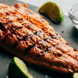 Close up of the grill marks on a grilled salmon fillet.