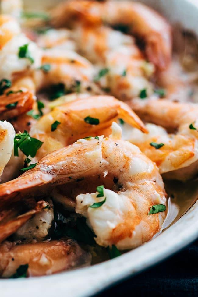 White dish with oven baked white wine garlic shrimp