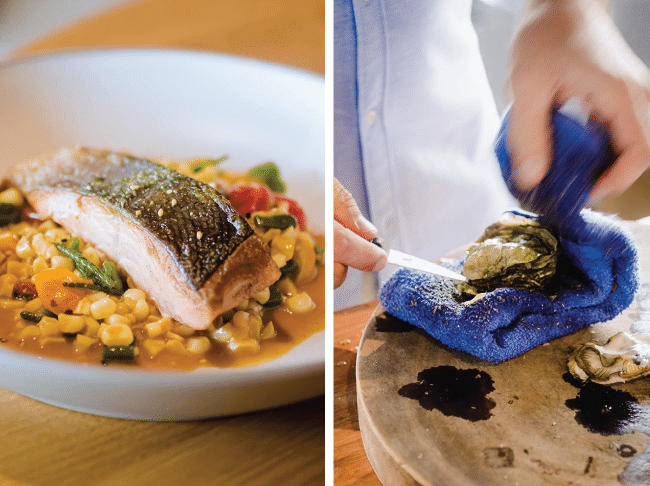 grilled salmon with corn succotash next to a man's hand shucking an oyster