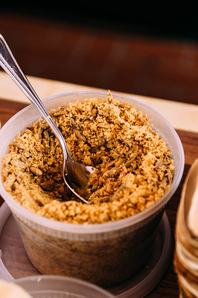 plastic container full of toasted breadcrumbs