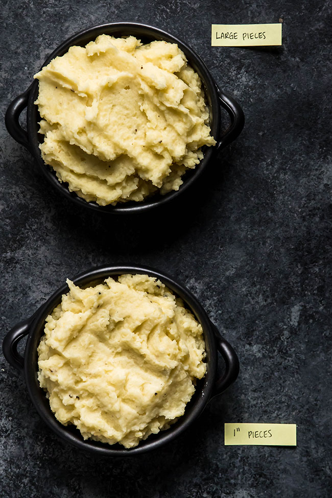 overhead photo of two black serving dishes full of mashed potatoes on a black background